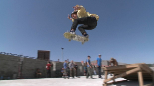 28- Professional skateboarder Louisa Menke gets some air during a demo at the Skateistan construction site
