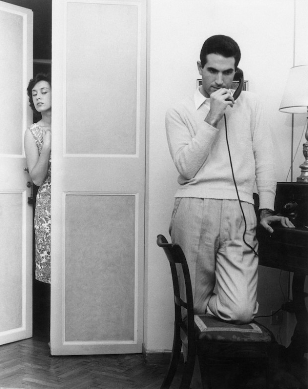A suspicious woman observing her husband at the phone